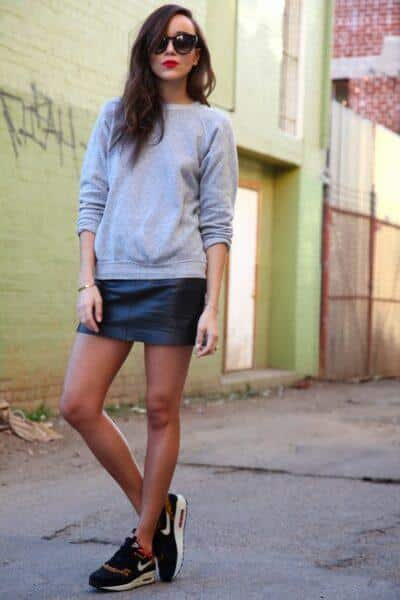 leather skirt and sneakers outfit