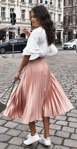 pleated skirt and sneakers outfit