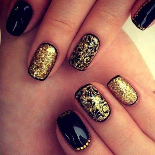 black and gold nails with rhinestones