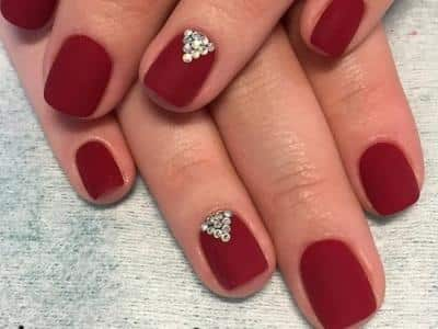 dark red nails with rhinestones