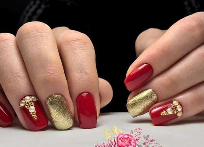 Red and gold nail with rhinestones