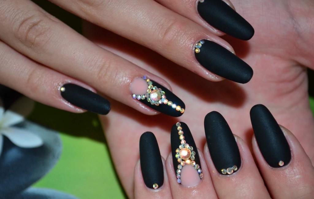 black negative space manicure with rhinestones