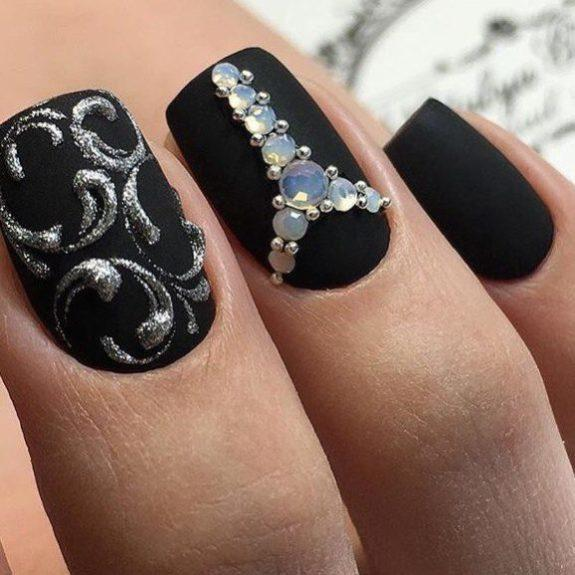 Black matte nails with rhinestones
