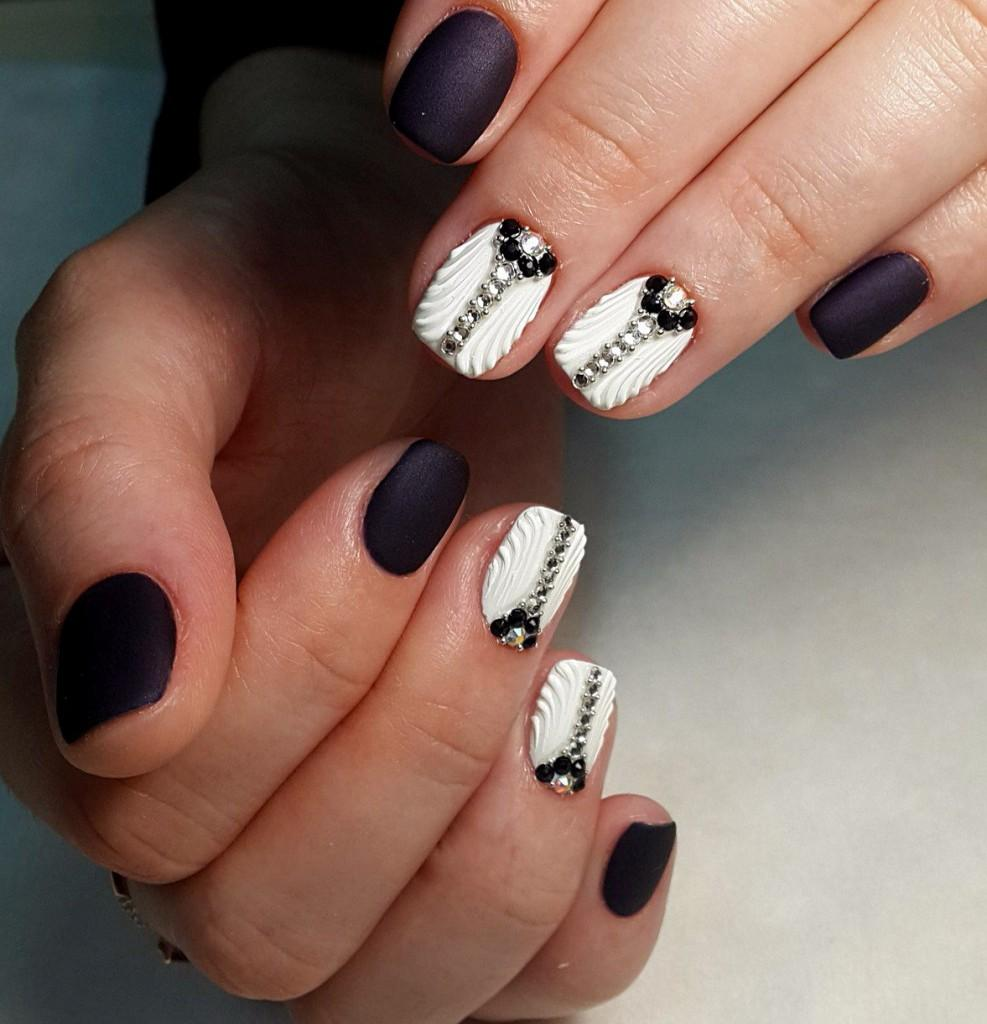 black and white manicure with rhinestones