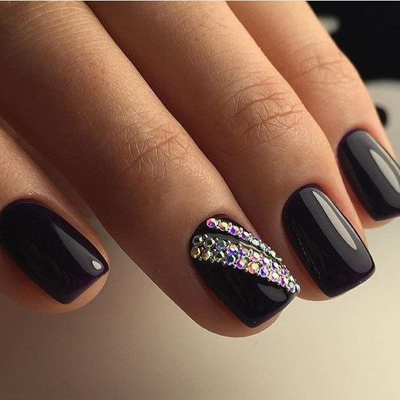 black manicure with rhinestones
