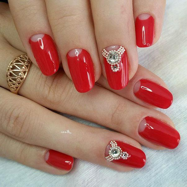 Red nail with rhinestones
