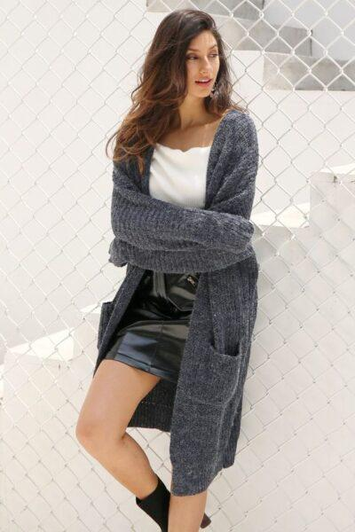 knitted cardigan with a short leather skirt