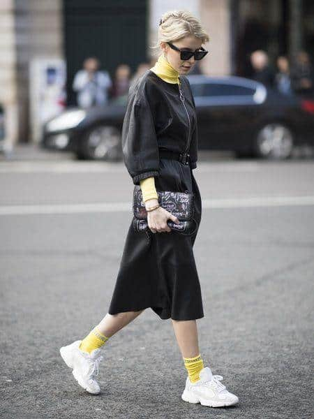 black dress with socks with white sneakers.