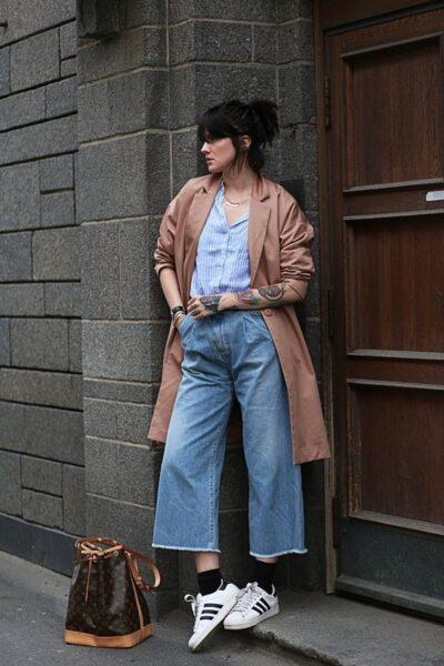 Which footwear should be worn with flared jeans